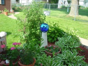 Here is a common looking gazing ball amid a little garden space.