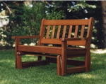 This outdoor glider is made of cedar - sits and glides beautifully.