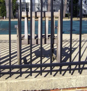The standard metal pool fence rails in black.