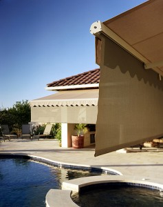Here are some images of retractable awnings with a scalloped edge and drop-down extra sun protection in desert tan.