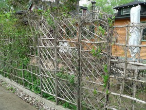 Here, a homemade trellis wall was made with twigs to create nice piece.